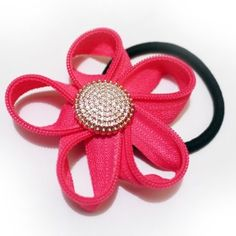 PONYTAIL HOLDER WITH FABRIC FLOWER