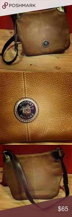 """Dooney & Bourke This Dooney & Bourke purse is a nice brown """"All Weather Leather"""" as indicated on the tag. It doesn't look extremely used due to its good condition! The quality of the bags is legendary. Offers are always welcomed! (: Dooney & Bourke Bags Crossbody Bags"""