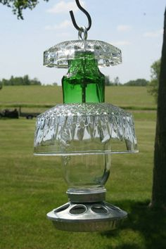 Homemade bird feeder - I could look for fun glass things at thrift stores and probably find something cool