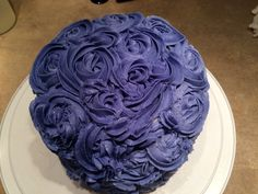 "10/12/15: cake #2, 6"" layer, white with raspberry filling. vanilla buttercream, purple rosette decoration."