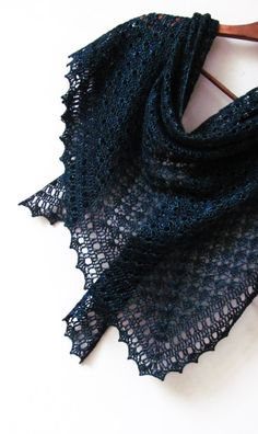 """Black Sea is a feminine triangle-shaped shawl worked top-down in a textured shell stitch. Size is easily adjustable and also depends on yarn you use. This design looks beautiful both in fine and thick yarn. Pattern both written and charted. Finished size: Wingspan 67"""" (170 cm), depth 31.5"""" (80 cm) Materials needed: •3 skeins of Lace Lux by Lana Grossa in shade 007 Teal or any Laceweight yarn, about 340 yards (310 meters) per 50 grams •3.5 mm (E) hook •Stitch markers •Blocking pins •Tapest..."""