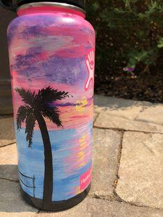 #46 and I'm still not tired of making them!  Follow my art Instagram @art_by_hannaht_   #handpaintedhydroflask #hydroflask #hydro #flask #sunset #beach #volleyball #pink #purple #tree #plamtree #blue #ocean #sun #vacation Water Bottle Art, Hydro Flask Water Bottle, Cute Water Bottles, Best Water Bottle, Water Bottle Design, Diy Bottle, Pink Hydro Flask, Hydro Painting, Tumblr Stickers