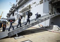 NORFOLK (Oct. 7, 2016) Sailors move supplies aboard the amphibious assault ship USS Iwo Jima (LHD 7) during an onload of more than 500 Marines from the 24th Marine Expeditionary Unit (24th MEU) and nearly 300 pallets of supplies. Iwo Jima is moored pierside at Naval Station Norfolk awaiting further tasking as Hurricane Matthew develops. (U.S. Navy photo by Petty Officer 3rd Class Jess E. Toner/Released)