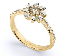 Star-shaped diamond ring in 18K gold, featuring a Fancy Yellow central diamond (4.40mm; 0.29ct) and 22 white brilliant-cut diamonds (0.36ct tw). • Breathtaking design • Magical details • Authentic diamond, ruby, emerald, sapphire rings