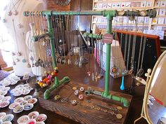 Pipes make a fitting display for necklaces made of hardware items. {craft booth setup}