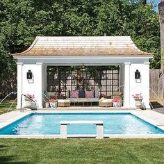Pool House with Floor to Ceiling Glass Windows