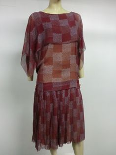 1920s geometric print silk chiffon tea dress with 3 layers of floaty silk chiffon over a neutral liner. Celluloid buttons at side of dropped waist.
