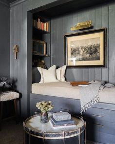 Cozy second bedroom alcove for bed. Love this color!