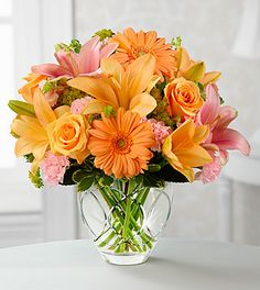 Product Description: The Brighten Your Day™ Bouquet by FTD® is blooming with brilliant color and cheer and is sure to lift their spirits with each exquisite bloom. Peach roses, gerbera daisies and Asiatic lilies bring a soft energy to this bouquet when combined with pink mini carnations, pink Asiatic lilies, bupleurum and variegated pittosporum. Beautifully presented in a designer clear glass vase, this bouquet creates a wonderful way to show them how much you care.GOOD bouquet is ...
