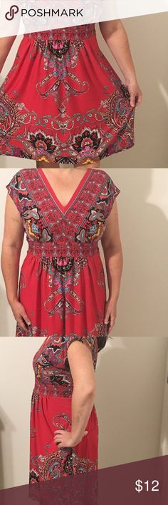 Pretty red paisley dress for summer Pretty red paisley dress perfect for summer. Very comfy and cool. Deep v neck and back. Empire Banded waist band at the front, elastic waistband at the back. Material is polyester spandex mix. Brand is by Kiara. Dresses