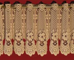 """Ava"" is an imported German Lace Curtain available in both Valance and Tier size.  As you can see in the picture it hangs beautifully.   The Valance comes in a 13"" height.  Fits up to 1/2"" diameter rods.  No sewing necessary.  This pattern is available in Beige (slightly lighter than Ecru).  It is easy to take care of because it is 100% washable poly."