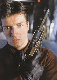 """Nathan Fillion as Captain Malcolm Reynolds """"Mal"""" from Firefly. Showing off the Moses Brothers Self-Defense Engine Frontier Model B (Mal's pistol from Serenity). Joss Whedon, Firefly Series, Firefly Quotes, Firefly Art, Science Fiction, Nathan Fillon, Malcolm Reynolds, Westerns, Sci Fi Tv"""