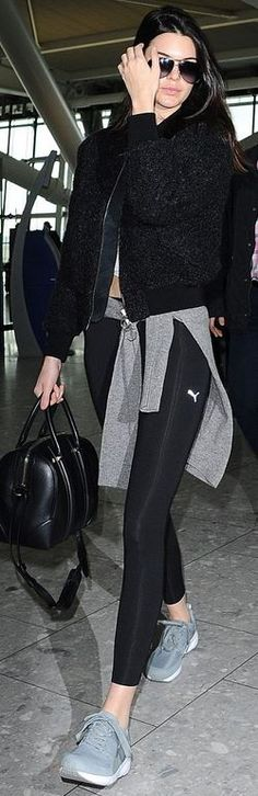 Kendall Jenner: Shoes and pants – Puma  Jacket – Acne  Sunglasses – Dolce & Gabbana  Pures – Givenchy