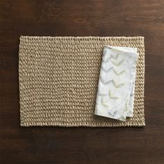 Lanai's intricate weave and pale neutral color represent an earthy yet sophisticated take on the fiber placemat.  Handcrafted, double-block printing technique lends depth and texture to this breezy, botanical-print napkin. 100% abaca placematClean placemat with a dry cloth100% handcrafted cotton napkinMachine wash napkin cold, tumble dry low; warm iron as neededMade in multiple countries.