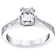 Win her hand and her heart with this stunning white gold and diamond engagement ring. With a half-carat emerald-cut stone prong set in the center and six baguette-cut diamond side stones, this 14-karat ring will dazzle her friends and family.