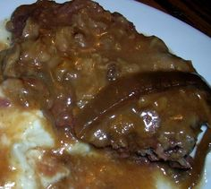 Slow Cooker Cube Steak With Gravy from Food.com! One of our favorite dishes... if I can turn this into a crockpot recipe even better! My sauce is a little different... cream of shroom & beefy mushroom is all I use! YUM... trying this for dinner tomorrow!