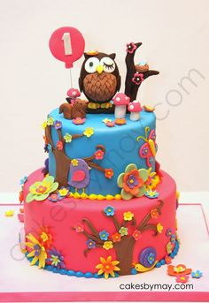 Owl 1st Birthday Cake - Lots of detail on this cake...owl, squirrel, butterflies, snails, flowers, flowers, and more flowers.