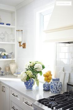Elegant Spring decorating using pretty blue and vibrant yellow accents along with real and faux florals to help bring a sophisticated yet relaxed feel to your home.