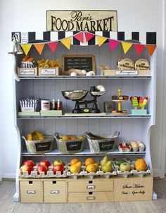Children's toys - A Parisian Food Market made from an old hutch and filled with play food and other items. Lovely addition to any kitchen set!