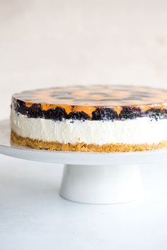 No Bake Rosé Cheesecake - Graham cracker crust, a rosé-infused no-bake cheesecake filling, topped with fresh blackberries and cantaloupe, and rosé gelatin.