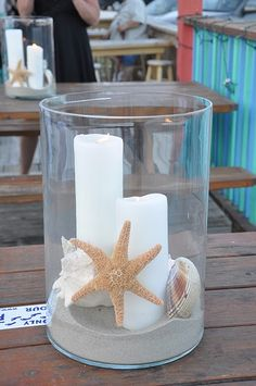 Hurricane glass with candles, starfish and shells for centerpieces Beach Theme Bathroom, Beach Bathrooms, Beach Room, Beach Crafts, Diy Crafts, Beach Cottages, Beach House Decor, Beach Themes, Coastal Decor