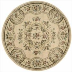 @Overstock - This brown, ivory, blue, green, burgundy rug features beautiful patterns that will enhance the decor of any room. Constructed of a soft wool blend, these durable rugs are hand carved for additional texture.http://www.overstock.com/Home-Garden/Chateau-Ivory-Rug-53-Round/6145875/product.html?CID=214117 $89.99