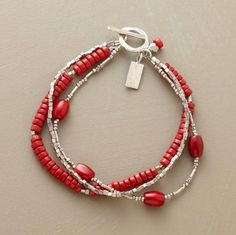 "Sterling silver's cool gleam highlights red coral's fiery warmth in a bracelet that embraces variety. Toggle clasp. Exclusive. Handmade in USA. 7-1/2""L."