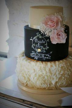 Chalkboard and ruffles wedding cake with pink roses and gypsophila, gold leaf heart detailing.#weddingcake #Handpaintedcake #sugarflowers #chalkboardcake #ruffles