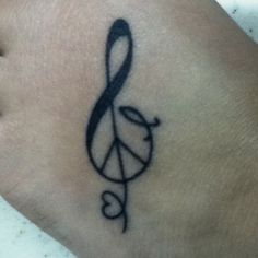 My tattoo. Treble clef. Peace sign. Jesus fish. Heart. Everything that means something wrapped up in one symbol. I like it because at first glance you don't notice it all but it's there if you take a deeper look. Just like me.