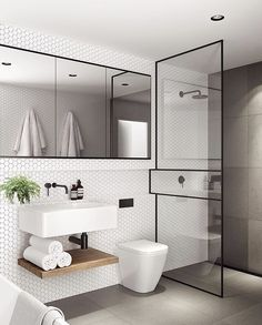 Love this! Black details, white hexagon tiles.