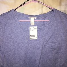Size small H&M blue t shirt NWT never worn size small blue H&M tshirt, with folded short sleeves and a breast pocket. Goes great with any outfit, and is very comfy. Fits sizes small and medium. Make me an offer :) H&M Tops Tees - Short Sleeve