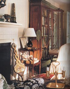 The living room furnishings are a mix of the worldly and the simple. - HouseBeautiful.com
