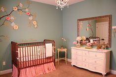 Such a sweet shabby chic nursery....love the tree and name above the crib!