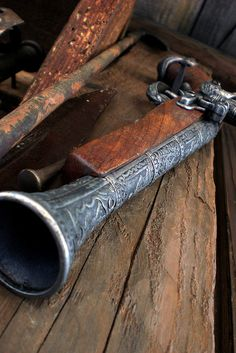 "A flintlock blunderbuss (the name is from the Dutch word ""donderbus"" which means ""thunder pipe"")"
