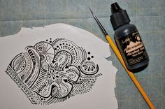 Page McNall applies her magic undiluted black alcohol ink.  She describes her process in a series of Flickr pictures.  ~ Polymer Clay Tutorials
