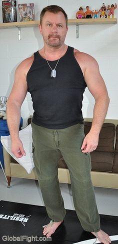 a hunky older muscleman bodybuilder tanktop