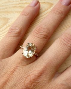 Oregon Sunstone and Diamond Ringcustom for Adam by kateszabone. Though I don't love colored stones this is beautiful!