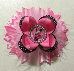 A personal favorite from my Etsy shop https://www.etsy.com/listing/266174012/minnie-mouse-stacked-hair-bow-disney