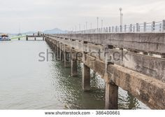 Old concrete pier in the evening, Cape Yamu, Thalang, Phuket, Thailand - stock photo