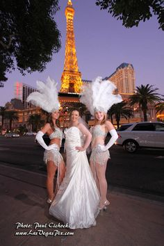 Showgirl entertainers pose with this bride...