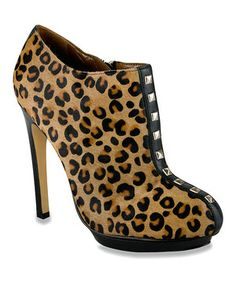 Maintain a fabulous sense of style with these bodacious booties. Boasting a supple pony hair and leather construction with lively leopard spots, edgy studded accents and a slender stiletto heel, this posh pair is a sweet treat for trend-savvy feet.