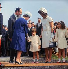 Unveiling: Former First Lady Jacqueline Kennedy took John John and Caroline with her to accompany Queen Elizabeth when the memorial was dedi...