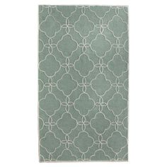 Hand-tufted rug with a quatrefoil motif.    Product: RugConstruction Material: PolyesterColor: Ocean