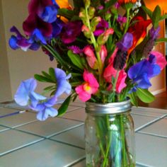 We had an 80th birthday party for my husband's grandma. These were the centerpieces, wild flowers in mason jars.
