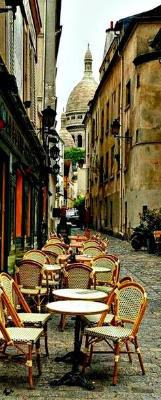 Love the buildings, depth of field and quaint cozy feel of the cafe seating. Cafe in Montmartre, Paris
