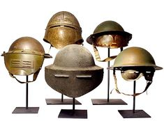 Pictured here are 8 very rare experimental military visor helmets. They were produced in limited quantities between WWI and WWII.