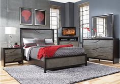 Shop for a Modern Wave Ebony  7 Pc Queen Bedroom at Rooms To Go. Find Bedroom Sets that will look great in your home and complement the rest of your furniture.