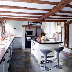 this kitchen would work in this space if they replaced the island with a table and chairs