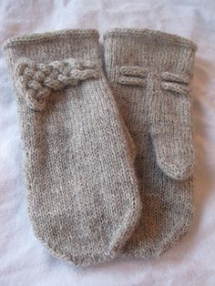 Free pattern of these knitted mittens embellished with a lovely knot - all included in the tutorial. http://www.ravelry.com/people/lanechka