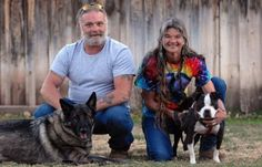 """At just 40 pounds, Oliver liked to leap from the porch in Erika Sprinkle's Kansas home and chase his """"brother,"""" a 128-pound German Shepherd named Boss Man, Gorant writes.  """"They were best friends,"""" Sprinkle said.  As much as he loved other dogs, Oliver needed time to feel safe around humans. It took a month before he gave her any kisses, but once he did, """"it just never stopped.""""The small black and white dog, who died in Sprinkle's arms in 2013 at age 7, embodied """"pure joy."""""""
